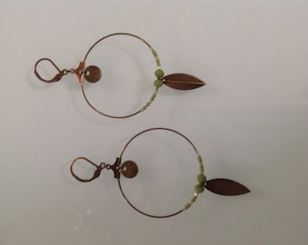 Bronze hoops and green beads.