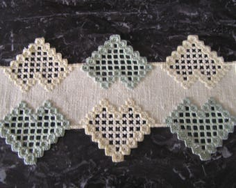 Yellow and green Hardanger embroidery doily