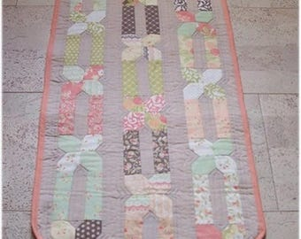 Salmon tone patchwork table runner