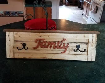 Family plaque with coat hangers