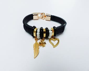 Pearl and heart leaf and 4 leaf clover charm bracelet black white and gold