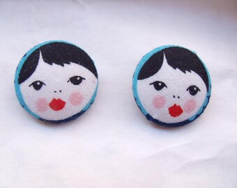 buttons covered with printed doll head