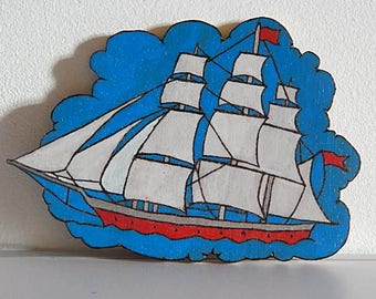 Hanging wall wooden sailboat scalloped and painted