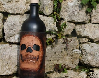 Bottle covered with leather - Skull