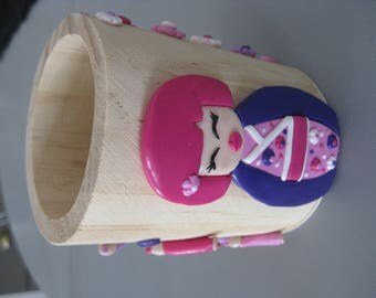 Pencil holder wooden girl with doll kokeski