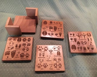 Wooden animal track drink coasters
