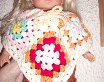 Crocheted wool poncho for doll