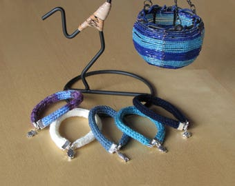Set of 5 acrylic bracelets in shades of blue, white and multicolor with silver-metal pendants. Bracelets with Pendants