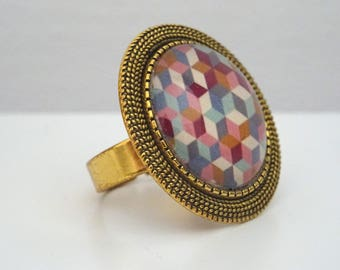 Ring cabochon gold patterns and colorful geometric triangles