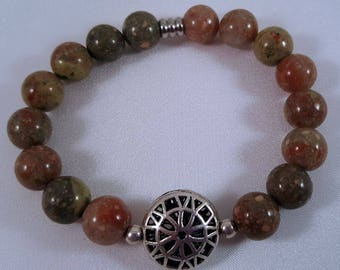 Precious stone bracelet made of jasper, metal ornament and stainless steel beads