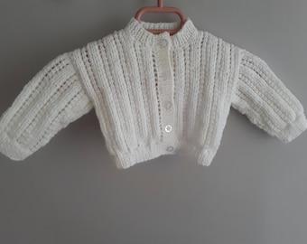 White baby girl's cardigan