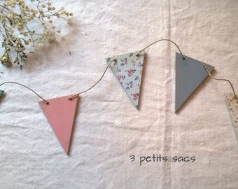 Garland pennants and patinas, papers, pastel colors.  shabby vibe