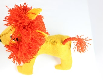 Handcrafted stuffed wool lion.
