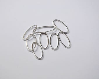 AP14 - Set of 8 charms between two silver metal