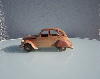 Wooden miniature of a Citroen CV 2 1/24 scale Juniper.