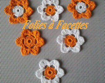 White and orange flowers and crochet cotton
