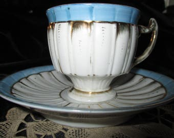 Victorian Teacup and Saucer.  Pale Blue, white and gold.