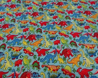 Patterns of sky blue dinosaur print cotton fabric