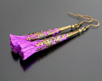 Purple tassel earrings.