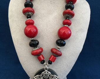 Red and black resin beads