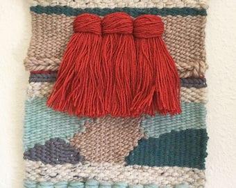 red tassels woven wall art