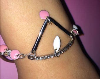 Pink and white charm bracelet