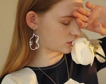 body shaped earrings