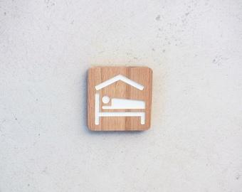Wooden door plate for a guest room