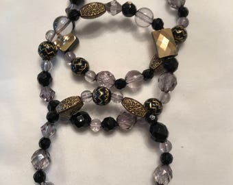 3 black/clear/gold bead stretch bracelet