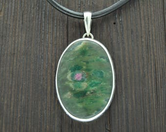 Silver pendant with Zoisite. Ruby in stone.