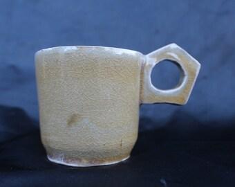 Pale yellow/green mug