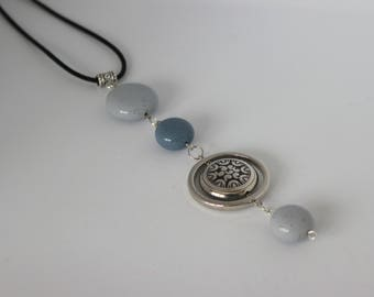 Original vertical necklace in metal and steel blue acrylic.