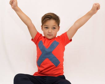 Summer T-shirt for boys, coral color, casual model with sewn textile simbol X sprayedwith different color of pain, short sleeves, slim model