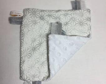 Graphic silver and white minky taggy blanket