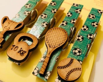Magnetic pegs with a sports theme and wooden embellishments
