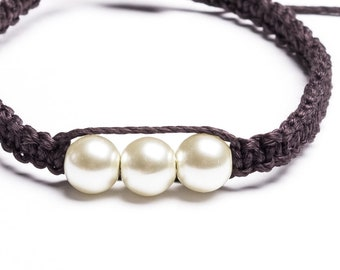 Black Friendship Macrame Bracelet with White Pearl in The Middle and Adjustable Bracelet.