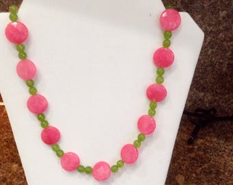 Large beautiful pink faceted jade beads with green peridot bead accents