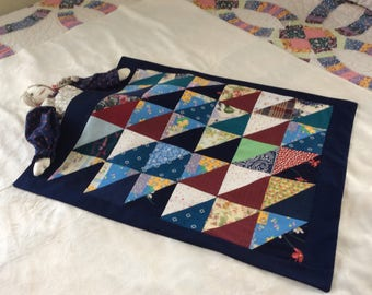 Beautiful half square triangle doll quilt