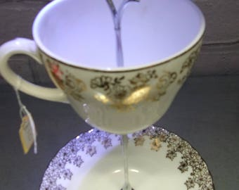 Tea cup and saucer jewellery, hair clips, staionery items stand