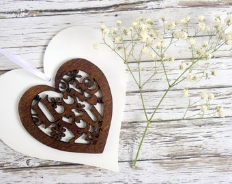 5th anniversary gift or Valentine decoration. Wood hanging heart ornament hand-painted white, with laser cut 'I love you' in dark wood