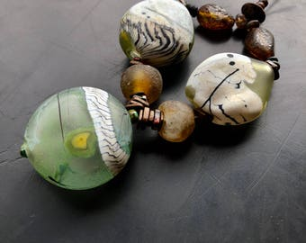 handmade lampwork glass blown bead set by lori lochner bronze moss and ivory rustic hollow blown