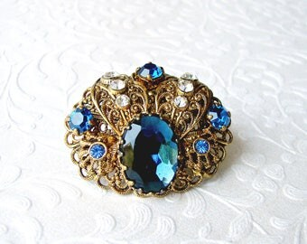 Vintage German Royal Blue Rhinestone Brooch Gold Tone Filigree Scrolled Dress Clip Gown Sash Coat Pin Formal Evening Wedding Something Blue