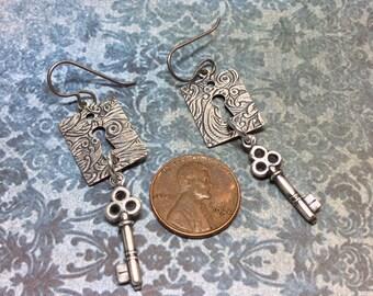 Handmade earrings escutcheon keyhole keys silver dangle steampunk mechanical romance
