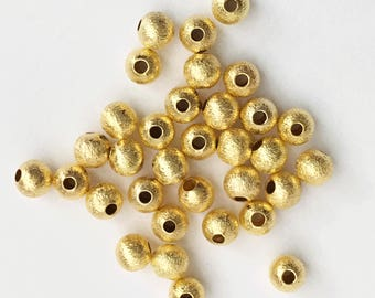 100 pcs of Gold plated round brushed beads 5mm