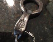 Ten hand-forged keychain-sized bottle openers for Alissa