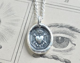 bleeding heart wax seal necklace - heart pierced with arrows  under an eye - soft hearted, kind, empathetic - post medieval wax seal jewelry