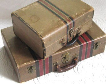 Vintage cardboard suitcase . vintage suitcase . paper lined suitcase. striped suitcase