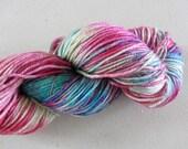 Neon Tetra.  Handpainted Sparkling merino yarn