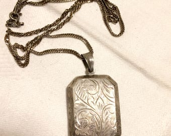Vintage Engraved Sterling Silver Rectangular Locket with Chain. Chain is 17 Inches, Locket is 1 3/4 Long with Bail and 7/8 Inch Wide. (D17)