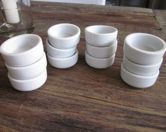 Vintage set of twelve individual French ironstone butter dishes.